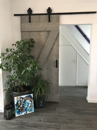Schuifdeur systeem grey wash woonkamer